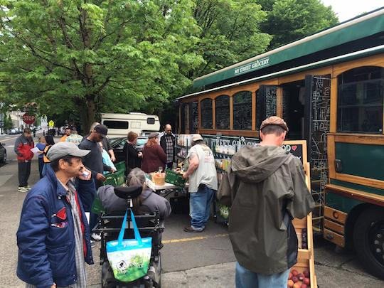 my-street-grocery-whole-foods-trolley-shoppers-outside